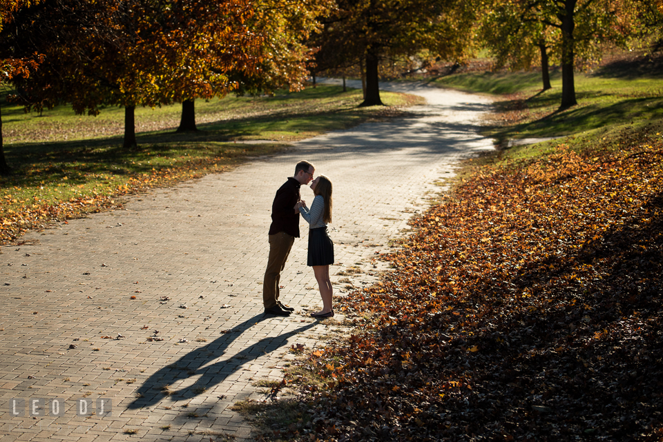 Patterson Park Baltimore Maryland engaged couple almost kissing on brick path photo by Leo Dj Photography.