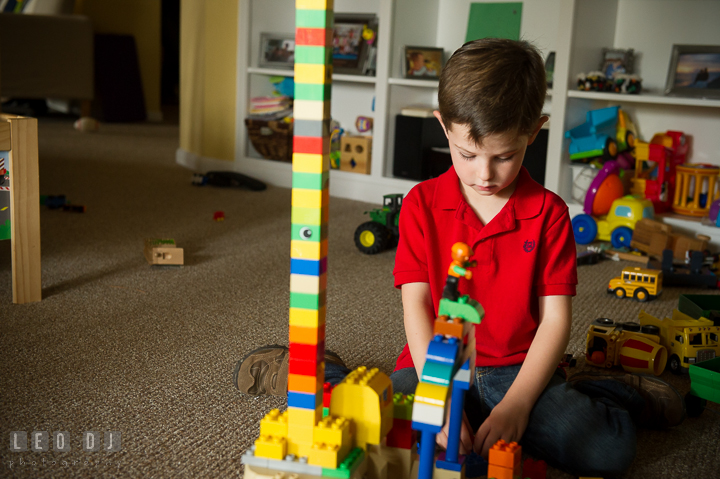 Toddler boy playing Lego Duplo in the basement. Queenstown, Eastern Shore Maryland candid children and family lifestyle portrait photo session by photographers of Leo Dj Photography. http://leodjphoto.com