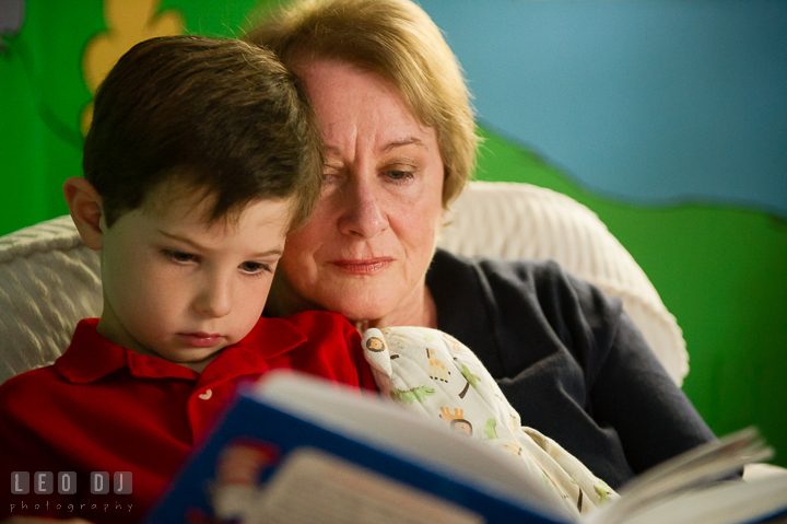 Toddler boy reading book together with his Grandmother. Queenstown, Eastern Shore Maryland candid children and family lifestyle portrait photo session by photographers of Leo Dj Photography. http://leodjphoto.com