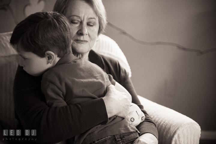 Grandmother hugging her grandson. Queenstown, Eastern Shore Maryland candid children and family lifestyle portrait photo session by photographers of Leo Dj Photography. http://leodjphoto.com