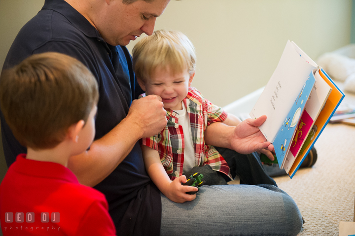Boys reading books together and laughing with their Father. Queenstown, Eastern Shore Maryland candid children and family lifestyle portrait photo session by photographers of Leo Dj Photography. http://leodjphoto.com