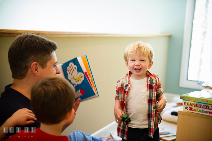 Little boy laughing as Dad reads book to him. Queenstown, Eastern Shore Maryland candid children and family lifestyle portrait photo session by photographers of Leo Dj Photography. http://leodjphoto.com