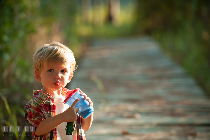 Little boy drinking chocolate milk. Queenstown, Eastern Shore Maryland candid children and family lifestyle portrait photo session by photographers of Leo Dj Photography. http://leodjphoto.com