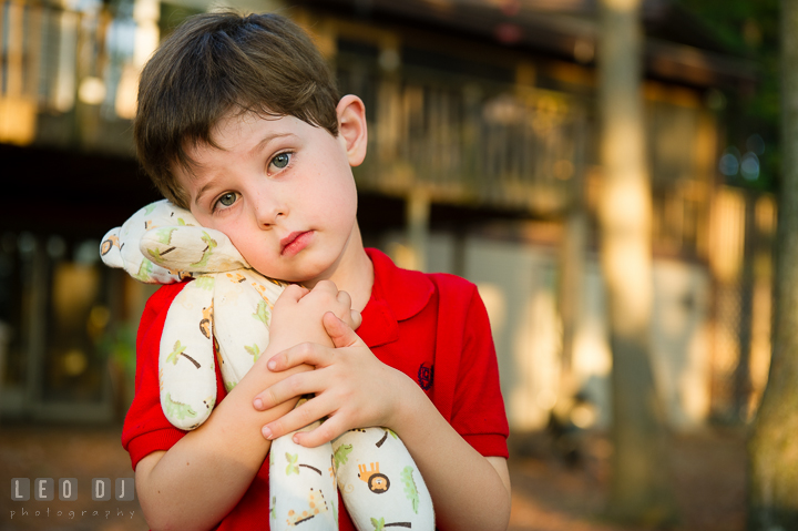 Toddler boy showing and hugging his favorite stuffed animal toy. Queenstown, Eastern Shore Maryland candid children and family lifestyle portrait photo session by photographers of Leo Dj Photography. http://leodjphoto.com