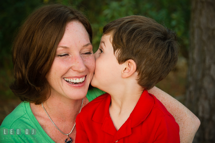 Toddler boy kissing his Mom's cheek. Queenstown, Eastern Shore Maryland candid children and family lifestyle portrait photo session by photographers of Leo Dj Photography. http://leodjphoto.com