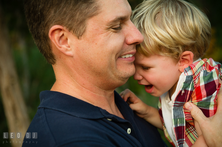 Dad playing and bonding with his youngest son. Queenstown, Eastern Shore Maryland candid children and family lifestyle portrait photo session by photographers of Leo Dj Photography. http://leodjphoto.com