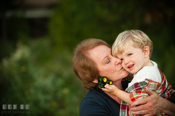 Grandmother kissing her youngest grandson. Queenstown, Eastern Shore Maryland candid children and family lifestyle portrait photo session by photographers of Leo Dj Photography. http://leodjphoto.com