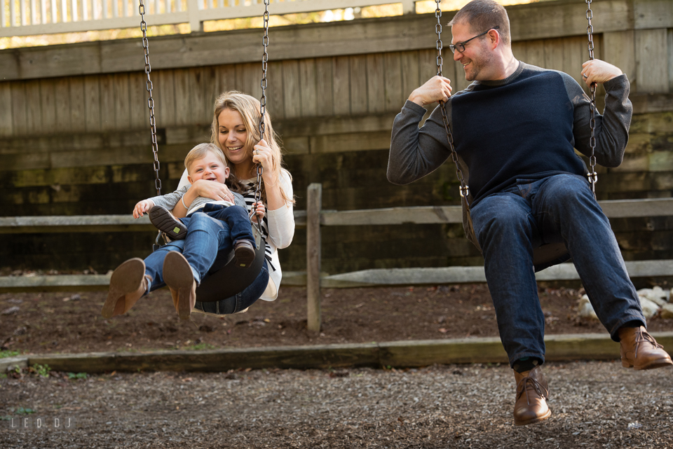 Quiet Waters Park Annapolis Maryland mom, dad, and son playing swing photo by Leo Dj Photography.