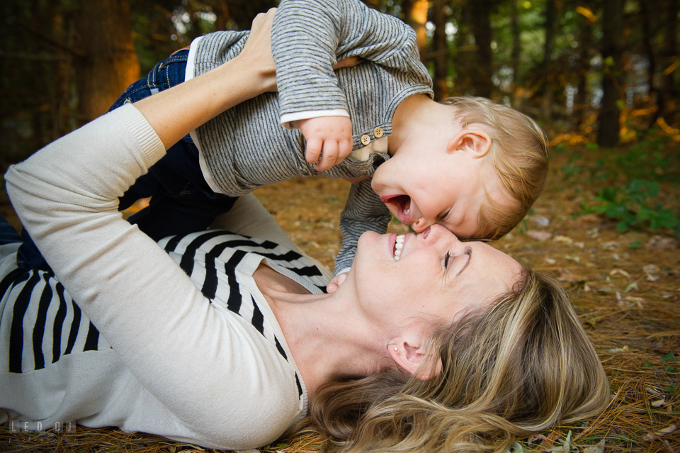 Quiet Waters Park Annapolis Maryland mom and son cuddling on the ground laughing photo by Leo Dj Photography.