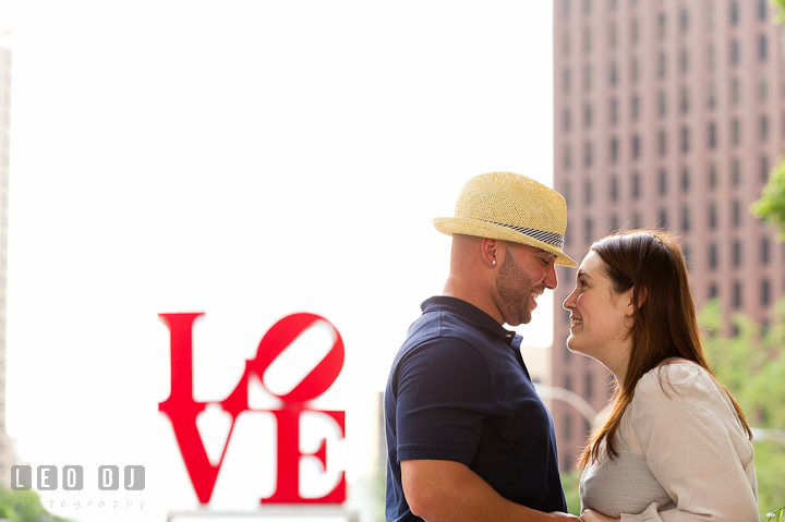 Engaged couple smiling together. Pre-wedding or engagement photo session at Phillies Ball Park, Love Park, Philadelphia, by wedding photographers of Leo Dj Photography.