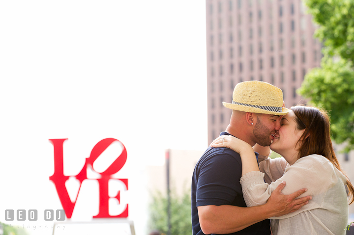 Engaged couple almost kissed. Pre-wedding or engagement photo session at Phillies Ball Park, Love Park, Philadelphia, by wedding photographers of Leo Dj Photography.