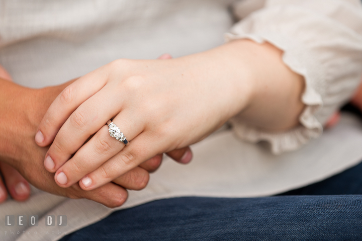Engaged couple holding hands, showing the diamond engagement ring. Pre-wedding or engagement photo session at Phillies Ball Park, Love Park, Philadelphia, by wedding photographers of Leo Dj Photography.