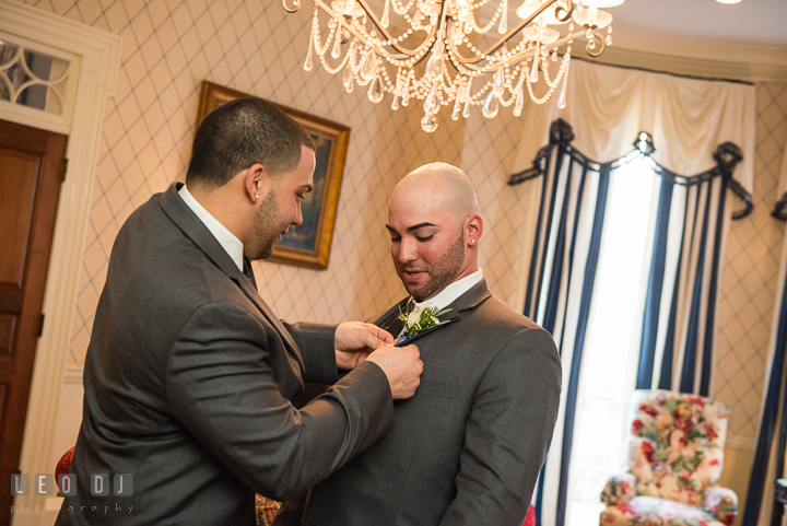 Best Man and Brother putting on the boutonniere. The Tidewater Inn Wedding, Easton Maryland, getting ready photo coverage by wedding photographers of Leo Dj Photography. http://leodjphoto.com