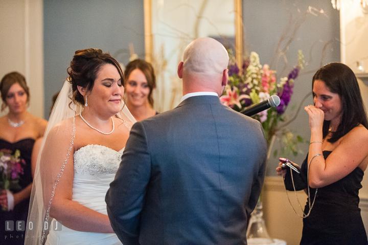 Bride emotional during reading. The Tidewater Inn Wedding, Easton Maryland, ceremony photo coverage by wedding photographers of Leo Dj Photography. http://leodjphoto.com
