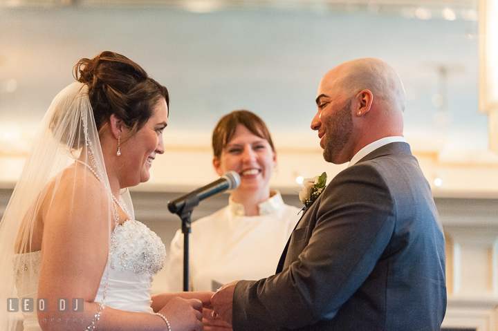 Bride and Groom exchanging wedding rings. The Tidewater Inn Wedding, Easton Maryland, ceremony photo coverage by wedding photographers of Leo Dj Photography. http://leodjphoto.com