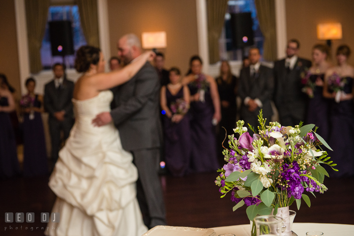 Bride's floral bouquet with Bride and Groom dancing in the back ground. The Tidewater Inn Wedding, Easton Maryland, reception photo coverage by wedding photographers of Leo Dj Photography. http://leodjphoto.com