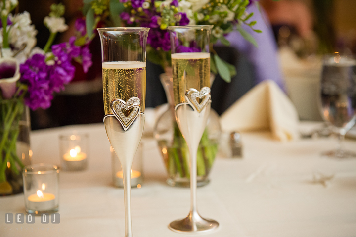 Bride and Groom's champagne glasses for toasts. The Tidewater Inn Wedding, Easton Maryland, reception photo coverage by wedding photographers of Leo Dj Photography. http://leodjphoto.com