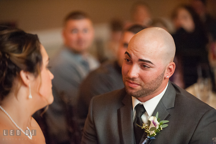 Groom looking at Bride at sweet heart table during speech. The Tidewater Inn Wedding, Easton Maryland, reception photo coverage by wedding photographers of Leo Dj Photography. http://leodjphoto.com