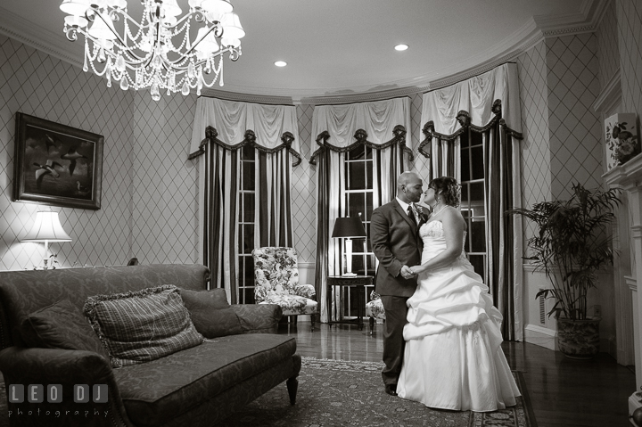 Bride and Groom in a beautiful room with antique furnitures and decorations. The Tidewater Inn Wedding, Easton Maryland, reception photo coverage by wedding photographers of Leo Dj Photography. http://leodjphoto.com