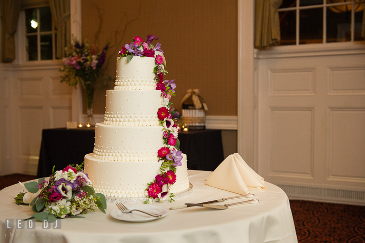 Four tier cake from Julie Bakes decorated with flowers from Seaberry Farm. The Tidewater Inn Wedding, Easton Maryland, reception photo coverage by wedding photographers of Leo Dj Photography. http://leodjphoto.com