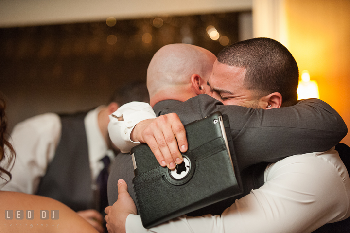 Groom hugged Best Man and Brother after speech. The Tidewater Inn Wedding, Easton Maryland, reception photo coverage by wedding photographers of Leo Dj Photography. http://leodjphoto.com