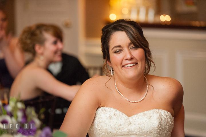 Bride laughing during speech. The Tidewater Inn Wedding, Easton Maryland, reception photo coverage by wedding photographers of Leo Dj Photography. http://leodjphoto.com