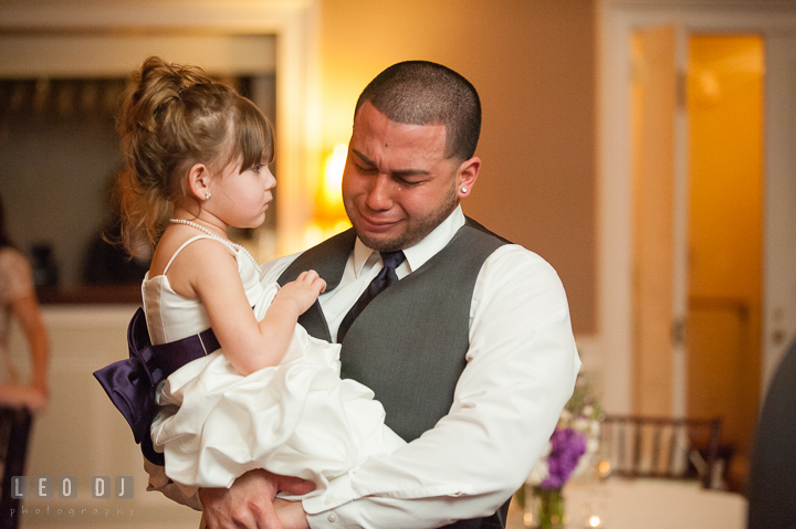 Flower girl looking at Best Man and uncle crying. The Tidewater Inn Wedding, Easton Maryland, reception photo coverage by wedding photographers of Leo Dj Photography. http://leodjphoto.com