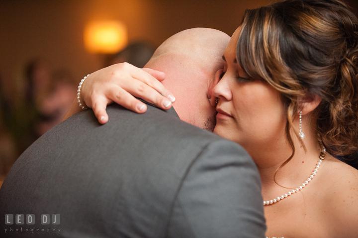 Bride hugged Groom with love. The Tidewater Inn Wedding, Easton Maryland, reception photo coverage by wedding photographers of Leo Dj Photography. http://leodjphoto.com