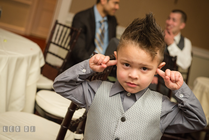 Ring bearer boy cover ears due to loud music. The Tidewater Inn Wedding, Easton Maryland, reception photo coverage by wedding photographers of Leo Dj Photography. http://leodjphoto.com
