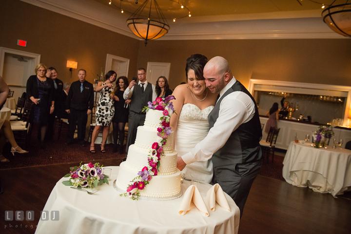 Bride and Groom cutting the wedding cake. The Tidewater Inn Wedding, Easton Maryland, reception photo coverage by wedding photographers of Leo Dj Photography. http://leodjphoto.com