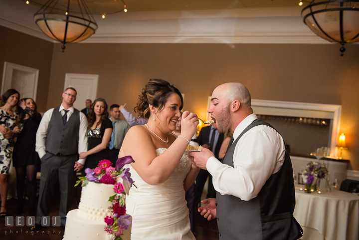 Bride and Groom feeding cake to each other. The Tidewater Inn Wedding, Easton Maryland, reception photo coverage by wedding photographers of Leo Dj Photography. http://leodjphoto.com