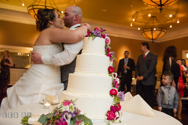 Bride and Groom hugging after the cake cutting. The Tidewater Inn Wedding, Easton Maryland, reception photo coverage by wedding photographers of Leo Dj Photography. http://leodjphoto.com