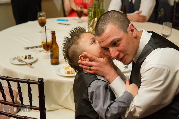 Ring bearer boy whispering to his Daddy. The Tidewater Inn Wedding, Easton Maryland, reception photo coverage by wedding photographers of Leo Dj Photography. http://leodjphoto.com