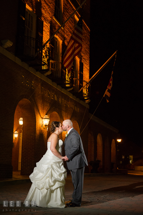 Bride and Groom kissing in front of the venue entrance. The Tidewater Inn Wedding, Easton Maryland, reception photo coverage by wedding photographers of Leo Dj Photography. http://leodjphoto.com