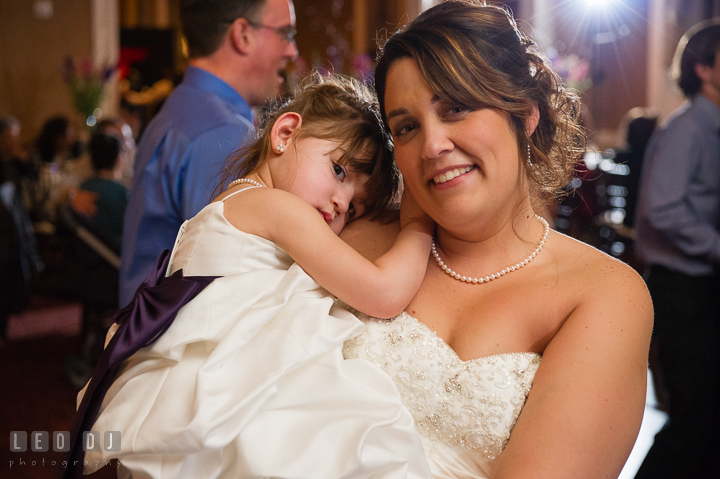 Bride carrying her daughter, the flower girl. The Tidewater Inn Wedding, Easton Maryland, reception photo coverage by wedding photographers of Leo Dj Photography. http://leodjphoto.com