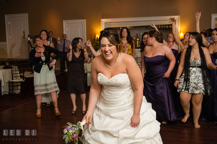 Bride laughing, getting ready to toss the flower bouquet to the single ladies. The Tidewater Inn Wedding, Easton Maryland, reception photo coverage by wedding photographers of Leo Dj Photography. http://leodjphoto.com