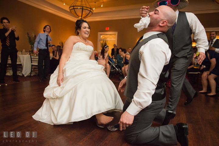 Groom grabbed the garter from Bride with his mouth. The Tidewater Inn Wedding, Easton Maryland, reception photo coverage by wedding photographers of Leo Dj Photography. http://leodjphoto.com