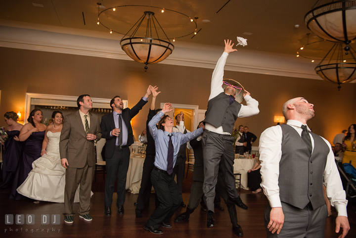 Groom tossed the garter to the single men crowd. The Tidewater Inn Wedding, Easton Maryland, reception photo coverage by wedding photographers of Leo Dj Photography. http://leodjphoto.com