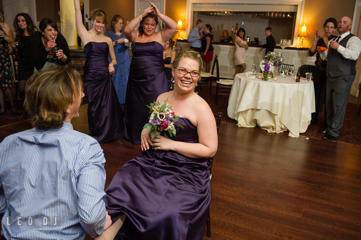 Male guest put garter on Bridesmaid who got the bouquet. The Tidewater Inn Wedding, Easton Maryland, reception photo coverage by wedding photographers of Leo Dj Photography. http://leodjphoto.com