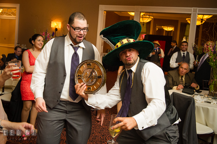 Groomsment wearing silly costumes from Annapolis Photo Booth. The Tidewater Inn Wedding, Easton Maryland, reception photo coverage by wedding photographers of Leo Dj Photography. http://leodjphoto.com