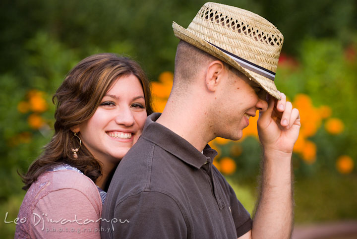 Engaged girl hugging her fiancé from behind. Pre-wedding engagement photo session at Brookside Gardens, Wheaton, Silver Spring, Maryland, by wedding photographer Leo Dj Photography.