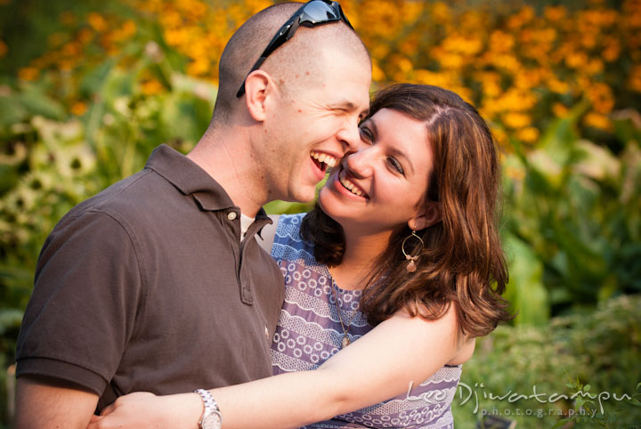 Engaged couple laughing and having fun. Pre-wedding engagement photo session at Brookside Gardens, Wheaton, Silver Spring, Maryland, by wedding photographer Leo Dj Photography.