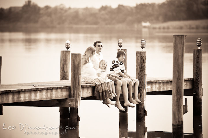 Family sitting on pier, bare feet. Kent Island and Annapolis, Eastern Shore, Maryland Candid Family Maternity Session Photographer
