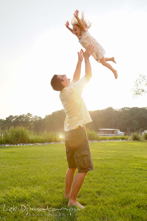 Father playing with her daughter, throwing her up in the air. Kent Island and Annapolis, Eastern Shore, Maryland Candid Family Maternity Session Photographer