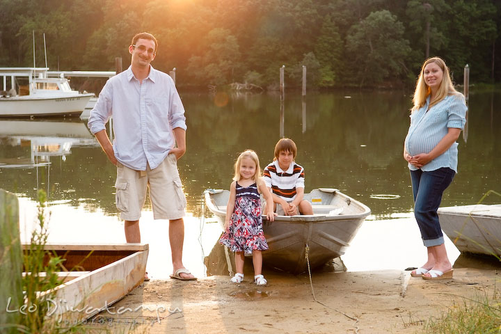 Whole family posing by the water and boat. Kent Island and Annapolis, Eastern Shore, Maryland Candid Family Maternity Session Photographer