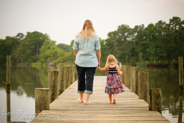Mother and daughter walking down the pier. Kent Island and Annapolis, Eastern Shore, Maryland Candid Family Maternity Session Photographer