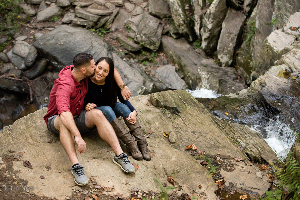 Rocks State Park Bel Air Maryland engaged man kiss fiancée by waterfall photo by Leo Dj Photography.