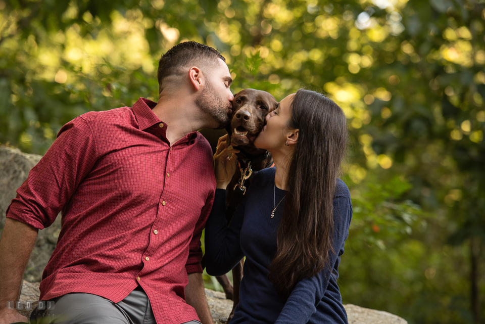 Rocks State Park Bel Air Maryland engaged girl and fiance kiss dog photo by Leo Dj Photography.