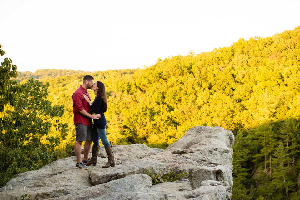 Rocks State Park Bel Air Maryland engaged man and fiancee kissing on King and Queen Seat photo by Leo Dj Photography.