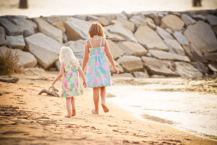 Two girls walking on the sand at sunset. Kent Island, Annapolis Maryland candid children lifestyle portrait photo at beach and farm